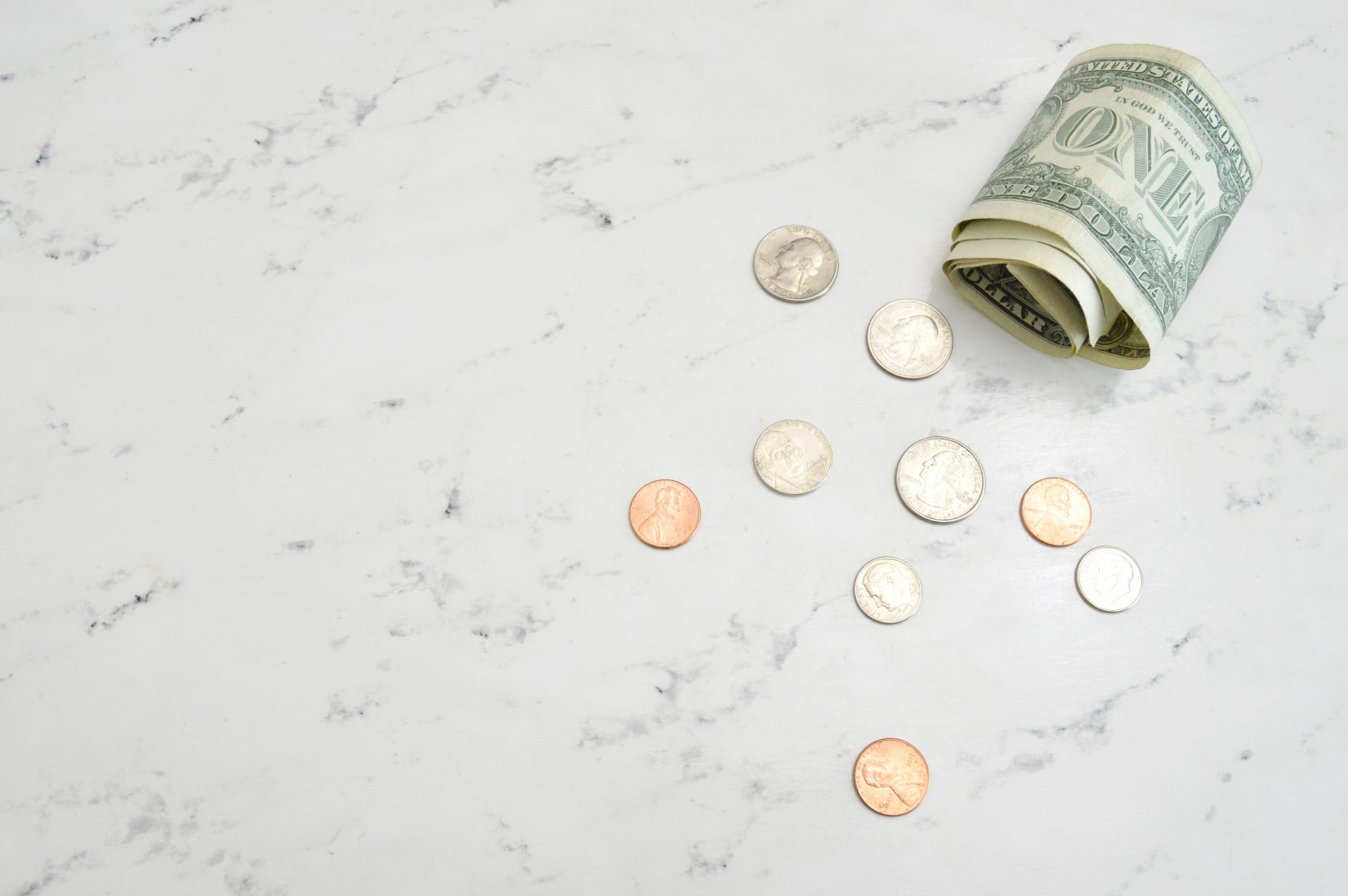 cash and coins on a countertop