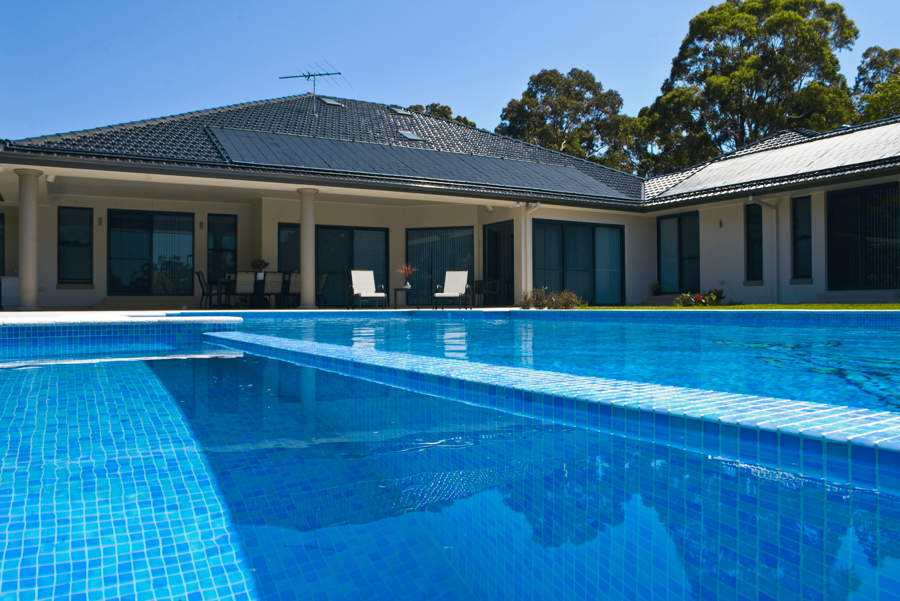 House with solar pool heating panels