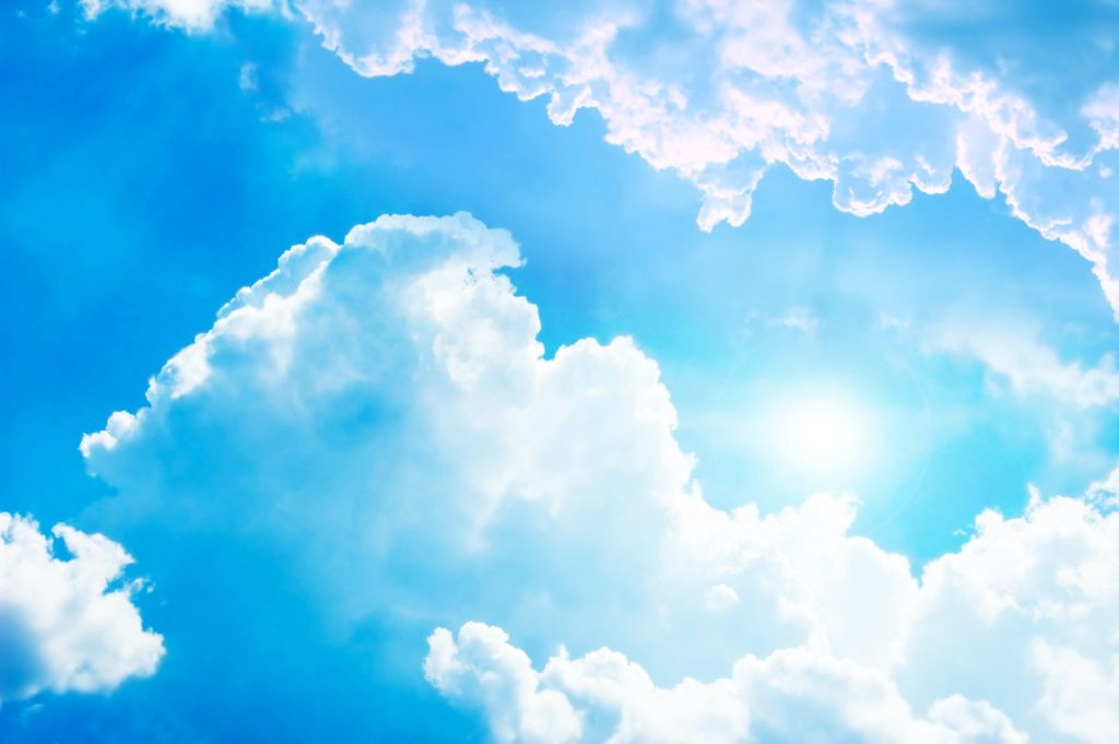 sunny day with blue sky and puffy white clouds